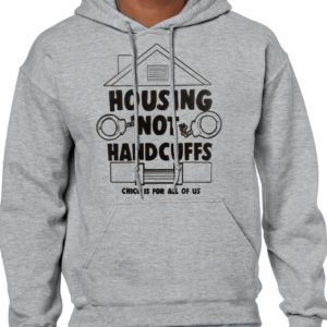 Photo of man in gray hoodie with housing not handcuff print